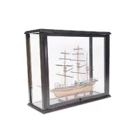 This beautiful display case was made out of hard wood and painted in dark mahogany color. It has distinctive designs that add elegance and beauty when displayed in your home or office. It is 100% fully assembled and comes with panels on all sides. It features an easy access door or panel to move your ship in and out from the display case.This case is very effective when it comes to preventing dust particles as well as keeping your valuable tall ship looking new and protected at all time. It is...