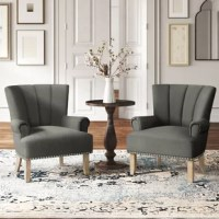 This rolled armchair is the perfect piece to create a cozy seating area in your home or add an extra spot to sit in your bedroom. It's founded top a solid and engineered wood frame, with tapered, square legs down below. It features a squared back with channel tufting and rolled arms for a traditional appeal. Assembly is easy: Just attach the legs! Best of all, it arrives in a set of two. Hand-curated by Kelly Clarkson.