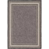 Set an understated foundation in any indoor or outdoor arrangement with this versatile area rug. Machine-woven in Turkey from polypropylene, this durable design resists water, staining, and fading. Its color-block border offers a dash of distinction, while its solid hues blend with a variety of color palettes and aesthetics. Thanks to this piece's low 0.25