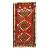 Add a touch of elegance to your home with this casual chic hand woven Kilim wool rug. Constructed on a loom by Nomad Turkman people with hand-spun wool and 100% natural vegetable dyes this beautiful rug is known for its beautiful repetitive geometric pattern with naturalistic floral and traditional patterns. The contemporary fashion palette produces bold, sharp patterns that are ingeniously versatile as the pattern is the same on the front and back. This double-sided rug is designed to be used...