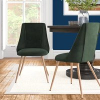 Give your dining room a modern update with this stylish side chair. Crafted from metal and engineered wood, this piece features slim crossed metal legs and a curved back that creates a clean-lined silhouette. And its neutral hue meshes well with any color palette in your home. Arriving in a set of two, this chair is also perfect for the living room or guest room.