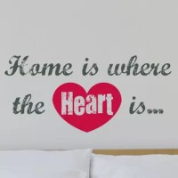 Home is Where the Heart Is wall quote brings a poignant sentiment to any room. These poetic words on the wall include a red heart for an artistic twist.