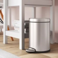 This 1.2 Gallon Round Step Trash Can is perfect for smaller spaces like a bathroom or an office. It features a durable steel pedal that opens the lid smoothly and a removable inner bucket for easy trash disposal.