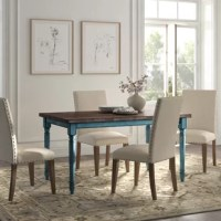Whether you're looking for dining table replacement or are filling out a new space, this dining table is just what you've been looking for. Made from solid and engineered wood, it showcases a clean-lined rectangular tabletop with visible wood grain for a rustic look. Down below, four turned legs in a contrasting color round out this table in traditional style, making it the perfect pick for French country aesthetics. This table comfortably seats six, and requires full assembly. But once...