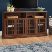 Give your living room a touch of traditional design with this rustic TV stand. Crafted from engineered wood, it features crown molding on the surface top and a clean-lined silhouette that fits in perfectly with your country cottage or farmhouse decor. The spacious surface top is capable of holding flatscreens up to 65