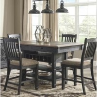 Create a cohesive look in your dining room all at once with this 5-piece dining set! The table is crafted from solid wood, and features a four-legged pedestal base with built-in shelving and a wine rack, so you can easily keep a favorite bottle in easy reach. The four chairs are also from solid wood as well, and feature a curving back with four splats for little extra support. Plus, each seat is upholstered with a polyester blend fabric for a welcoming touch during dinner. Two-tone finishes...