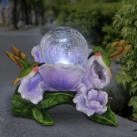 A magical solar crackle glass orb blossoms out of beautifully hand-painted petals. Adorable and inquisitive hummingbirds peek in as the orb automatically illuminates at dusk, adding a warm glow to your landscape. A charming addition to your garden.