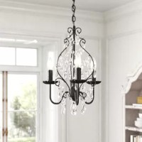 Create an eye-catching focal point in your home and brighten up a dim room all at once with this 3-light chandelier! Crafted from metal with an oil-rubbed bronze finish, it features three candle-style lights on curving arms for a classic look. That traditional feel gets a glam update thanks to this fixture's net of dangling crystal accents that add some elegant romance wherever it hangs. Each light accommodates a single 40W candelabra bulb, although none are included. And since it measures 15''...
