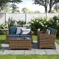 Perfect for petite patios and big backyards alike, this three-piece seating group set includes two loveseats and one rectangular coffee table so you have space for four to sit back and relax outdoors. Crafted with a powder-coated steel frame, each weather-resistant piece is wrapped in woven resin wicker in several shades for a breezy and approachable look. Foam-filled cushions with removable polyester-blend cover top the seats, providing padding as you kick back and unwind, while a tempered...