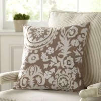 Add charm with this pillow cover. White floral-and-leaf patterns and hints of gold swirling over stone-colored chambray fabric provide a playful pattern and unique palette.