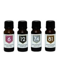Scent an entire room with this boxed set of home fragrance oils. Set includes 1 each of No. 74 Coconut Citrus, No. 12 Mahogany Oak, No. 81 Rum Teakwood, and No. 6 Lotus Amber capturing the faraway fragrances of tropical locations with accords of mahogany, teak, coconut, black tea, amber, and spice.