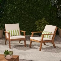 Capture the essence of outdoor lounging with a set of cozy club chairs. With immaculate lines and precise angles, this chair set gives your outdoor area a sleek, clean look. This includes a streamlined structure with its open slat backrest and seating, making this a breezy accessory for your decor. Featuring acacia wood frames with water-resistant cushions, these chairs are as functional as they are comfortable. From weekend afternoons on your patio to poolside lounging, our club chairs are...