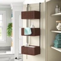 Organize everything from towels to craft supplies with this three-tiered, over-the-door storage. Its woven rattan baskets sit in a vertical row, and are supported by two metal tubes that conveniently hook over most doors. Its metal frame is finished in a black hue, which pairs well with the espresso-finished baskets. Each basket measures almost 12'' W, and this storage unit holds up to 10 lbs. in total. Assembly is required: Be sure to have a screwdriver on hand.