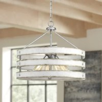 As much a work of art as a lighting fixture, chandeliers elevate the look of any space. This drum-shaped pendant is perfect for an entryway in need of a little illumination, a staircase seeking brightening, or a kitchen island searching for some shine, this versatile luminary is the perfect pick to add a touch of industrial-style wherever you install it. Four lightbulbs of up to 75 W each (bulbs not included) are spaced around the base, behind the graphite frame shade. This fixture can be...