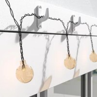 Perfect for illuminating your patio, this 30-count string light set arrives with a panel, solar rechargeable battery and a string of lights that are ideal for lighting up outdoor gatherings. If the panel receives 6-8 hours of full direct sunlight, the lights are capable of operating for 7-8 hours in the evening after the sun goes down, so you can enjoy them throughout the night. Also, a dual-mode button allows you to have the lights shine steady, or you can make them flash with the push of a...