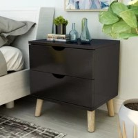Let your teen tuck away bedside essentials in style with this clean-lined nightstand. Made from manufactured wood, it features two drawers with cutout handles that provide a place for vitamins, contacts, books, and beyond. Splayed legs bring a bit of mid-century modern flair, while a neutral finish gives this design the versatility to complement any color palette. Standing just 22