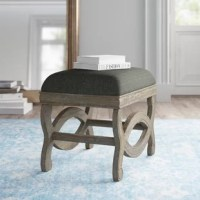 With a versatile design and plenty of style, this ottoman is just the thing for rounding out your seating arrangement with an extra soft touch. Crafted with a solid wood frame, this piece features a foam-filled seat with cotton-blend upholstery for an inviting feel. Below the seat, the legs and frame feature an eye-catching scroll motif for a little French country appeal in your living room. And with a seat height of 19'' H, it's a high-profile ottoman ideal for higher couches.  Hand-curated by...