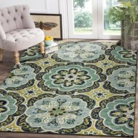 Add a pop of color and texture to any décor with this Fantastic Floret Hand-Tufted Wool Green Area Rug. This piece was hand-tufted in India using a unique loop pile design and is naturally durable and soft.