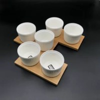 """Combing pure soft white porcelain with bamboo trays is a natural progression and is meant to showcase the food or whatever you decide to put inside these amazing vessels. Double-walled thermal glass from Wilmax is produced with a layer or vacuum trapped between 2 pieces of hand-blown thermos glass. This 9 piece set makes 3 perfect settings of two gang circle cutout bamboo trays with (2) two 3.5"""" ramekins each. Your only limit is your imagination. Anything is possible with this amazing..."""