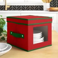 Stash your seasonal serveware in style with this holiday salad plate or bowl storage chest, perfect for keeping your dishes safe and dust-free. Made from polyester plastic, it can hold up to 12 plates or bowls and features felt dividers to keep your dishes protected and chip-free. A convenient top helps to secure its contents, while a clear window on the front of the box allows you see what's inside with a quick glance. Though this piece is perfect for storing serveware any time of the year...