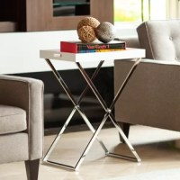 This product can be used in many ways around the home or office. Whether an accent side table beside a sofa or a night table that doubles as a bed tray, this stunning minimalist design is perfect for your space-optimized interior. The chrome criss-cross frame folds easily for storage while the cutout handles make it easy to remove the tray and convert to a portable TV, lap, or serving tray.