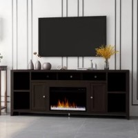 Missing the key ingredient in your living room to make all your guests keep coming back? Look no further than this sleek modern TV Stand with electric fireplace. Its sleek mocha finish and clean line design make it perfect as a focal point in your home. Bring the fire to a roar and embrace the warm glow and ambiance it provides. Used with or without heat, it contains remote settings for flame intensity, LED color options, and automatic timer function. Arriving fully assembled, it Includes...