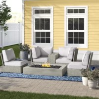 You can have a beach bonfire or cozy ski lodge fireplace right in your backyard with this 6-piece fire pit patio set. It includes a wicker sectional sofa and two armless chairs with oversized proportions and water-resistant, foam-filled cushions you can really stretch out on. The modular sofa includes a center table with cup holders to keep drinks close at hand, plus furniture clips to keep it all in place and looking just the way you like. This outdoor seating set is complete with a modern...