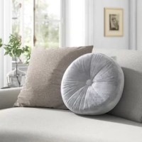 This circular button pillow is here to lend an eye-catching touch to your bed, sofa, or favorite chair. It features a cover crafted from a polyester blend, velvet-like fabric with a single button that lends it a textured, ruched look that's perfect for a glam feel. Inside, it features a hypoallergenic polyester filling, so you can spend more time relaxing and less time sneezing. A sewn seam helps keep the cover in place. To keep this piece feeling fresh, we recommend spot cleaning...