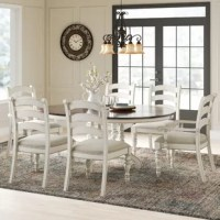 Pastoral elegance is the hallmark of this round dining room table. The table boasts a generous oval-shaped dining surface with a removable table leaf, along with a beautifully turned and stylized table leg with large block construction at the apron for strength. It can comfortably accommodate up to six diners, and features solid wood construction.