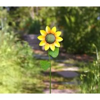 Add a classic look to your yard with the garden stake. Strong and durable, this windmill is crafted from iron and features beautiful weathered hues of red, yellow, and blue. In the center of the colorful blades sits a smiling sun that is fun and stylish. The colors blend together as the wind swirls the spinners to create a beautiful color collage. The sturdy construction is weather-resistant to last through all the seasons. Use the spinner as an accessory in your garden, by your patio, or in...