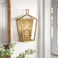 Highlight your home's hallway or bathroom in style with this open, antique-inspired wall sconce. It's made from metal with a tapered rectangular frame, and is finished in a neutral finish that adds a classic look. Its open design helps this elegant lighting fixture bring the look of an outdoor lantern indoors. And since it's rated for damp locations, this open lantern can be installed anywhere in your home, from the bathroom to the kitchen. Plus, two 60W bulbs are included.   Hand-curated by...
