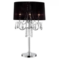 The ORE Crystal Drop Table Lamp with Drum Shade can add a touch of style and glamour to your home interiors. The sheer shade of this table lamp emits a warm and soft glow in the room. This table lamp features crystals, suspended from the column, that create subtle lighting effects. This lighting fixture is a part of the Crystal Drop collection. The ORE Crystal Drop Table Lamp with Drum Shade by ORE can accommodate 3 light bulbs. The use of steel in the making of this table lamp ensures durable...
