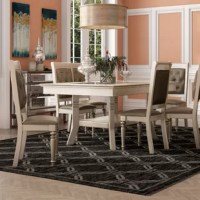 Live the lavish life and dine in luxury with this formal dining set the features a collection of furnishing hued in a silver finish trim. This collection is paired with silver finish trimmed chair. A rectangularly shaped table top with feminine curves and lines.