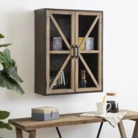 Install a decorative-yet-practical storage hutch in your home with the Mace wood wall cabinet. The Mace cabinet features a two-tone rustic brown wood and bronze metal finish that is distressed by hand for a farmhouse look. However, the Mace cabinet brings itself into the 21st century with the design of its two wooden doors, featuring glass panes and a modern, geometric overlay. These two doors are held in place by a central magnetic clasp, keeping your small tchotchkes and other items safe...