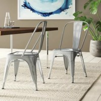When it comes to pulling up to a dining ensemble in on-trend style, chairs like these are a great option for an on-trend dinnertime perch. Crafted from steel, each seat in this set of four showcases a single splat and rounded back. Tapered legs and rivet details along with the seat round these chairs out with industrial-inspired style. Felt foot pads are included to help protect your floors. And with a stackable design, these seats are a space-conscious option for your dining ensemble.
