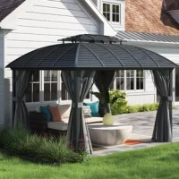 The Barreras Hardtop Permanent 12 Ft. W x 10 Ft. D Aluminum Patio Gazebo introduces the glamour and comfort of a resort experience into your everyday life. This gazebo elevates your backyard, or other outdoor space, adding an element of comfort and sophistication that's certain to impress your guests. The elegant curved design adapts well to many styles of patio furniture. This item is built for stability, with permanent aluminum, light non-rusting material that ensures your investment lasts...