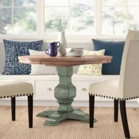 Bring traditional style to your dining room with this table, the perfect piece to act as the focal point of your ensemble! Crafted from solid wood, it stands atop a pedestal-style base with carved details and a solid finish, while the circular top and matching apron sport an oak hue with grain patterns for a contrasting touch. Measuring 45'' L x 45'' W x 30'' H, it seats up to four for a home-cooked meal.