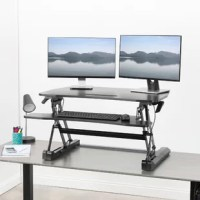 Enhance your work experience with Deluxe Adjustable Monitor Stand. This dual tiered platform sits on top of your current desk and gives you the benefit of standing or sitting on demand. The keyboard tray is removable for user preference. Transitioning between sitting and standing throughout the long work day provides numerous health benefits for the body such as increased blood flow and reduced aches and pains.