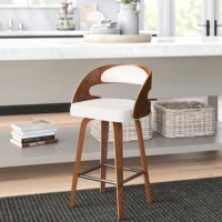 This collection blends mid-century modern and industrial modern styles with current design trends to create timeless pieces that will seamlessly compliment any decor. The mid-century modern bentwood frame swivel seat stool with fabric back and seat cushion, in walnut/beige, provides a retro touch for any of your counter height seating needs. This minimalist stool features a fabric seat cushion for extra comfort. The curved bentwood seatback also features a beige fabric cushion for plush...