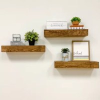 Beautify your space with these lavish looking shelves. Meticulously made from real sturdy wood, this set is full of natural character and appeal. Providing the perfect stage for your photos, decor, and more, the mantels furnish well in a living room or office. The shelves are easily installed and come equipped with all the necessary hardware.