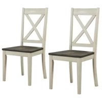 Spruce up your dining room decor with this rustic side chair set. Arriving in a set of two, these chairs come crafted from solid acacia wood and feature a neutral finish with distressed accents that highlight its natural wood grain. A decorative cross back adorns the back of each chair, while its scooped seating makes it easy to sit down for long dinners with friends and family. Capable of holding up to 300 lbs., this chair is an ideal table mate.