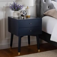 Bring both function and mid-century modern flair into your restful retreat with this nightstand. Founded atop four flared legs with sleek metal foot caps, it's crafted from manufactured wood and rubberwood in a solid glossy finish that's versatile enough to complement most color palettes. Two drawers on wooden slides provide a place for books, vitamins, and other bedside essentials. This low-profile piece is an ideal option for smaller spaces. Assembly is required.