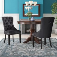 Dine-in luxurious style with this Stonefort Upholstered Dining Chair. Featuring a curved high back, plush cushioned seat and deeply tufted velvet upholstery studded with nailheads, this dining chair is sure to take your dining experience to a whole new level. Espresso wood legs provide sturdy support and complement the stunning upholstery for a sleek, contemporary design.