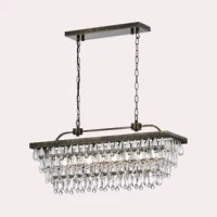 Create a dynamic and eye-catching focal point over your dining room table, your kitchen island, or anywhere else in your home with this striking chandelier. Perfect for adding a little French deco feel to your space, this piece is defined by it's tiered design, with glass bead accents that create a cascading effect from the rectangular, antique gold-finished metal backplate. This piece accommodates four 40W candelabra style bulbs, although none are included. And since it measures 15'' H x 30''...