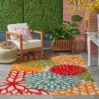 Add an extra layer of dimension, style, and personality to your home, with the addition of an area rug to your space. This one, for example, is perfectly at home in a contemporary aesthetic, with a vibrant floral motif, in a blue, green, red, and orange color palette. Machine-made in Turkey of 100% polypropylene, with a latex backing, and 0.25'' pile height. Being water and fade resistant, you'll love digging your toes into this stylish piece. We recommend using this design with a rug pad to...