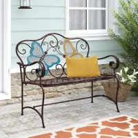 Relax in your yard on the bench! Your family and friends will delight in this chic outdoor furniture statement piece. This stylish bench features two beautifully crafted butterflies on the backrest of the bench. It is made of durable iron with a rustic, bronze finish that is weather-resistant to last for years of quality use. Enjoy a summer's day with loved ones while adding an elegant and timeless look to your garden, patio, deck, or garden.