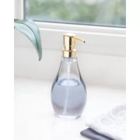 This Soap Pump is simple in style and form. Made from heavy-duty, molded acrylic, it is break-resistant and perfect for bathroom or kitchen use. Pump is silver-colored plastic; vessel has a 10-ounce capacity. Measures 7.5 inches Hx3.5 inches diameter. Coordinate your look with the entire bath accessory collection. Designed by Michelle Ivankovic for Umbra- the worldwide leader in casual and contemporary design for the home.