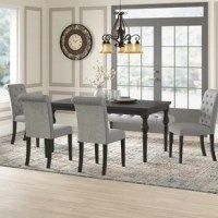 Brighten up any drab setting with this dining set. The table showcases an elegant design that begins with a rigid hardwood frame. Crafted of solid hardwood, featuring limed effects that enhance the contrast and character of the wood grain. Below, the traditional turned legs effortlessly draw the eye, which is lightly finished in a distressed look and wire brushed for timeworn appeal.
