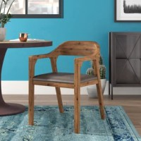 This Upholstered Dining Chair would be a great addition to your living room or kitchen. Constructed with solid acacia wood and upholstered PU padded seating. It is ready to assemble upon delivery with all tools and hardware included.