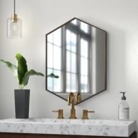 Aside from making spaces appear larger, wall mirrors offer a tactful, stylish way to hide imperfections, maximize light, and provide a second look at your favorite accents. This eye-catching hexagonal design showcases a beveled edge, and its shape is a great way to break up the straight lines of a gallery display wall. It's also just the right size for smaller wall spaces, or even directly above a sink, making it perfect for a vanity.